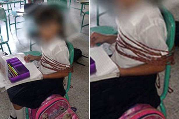 PAY Schoolgirl tied to chair main
