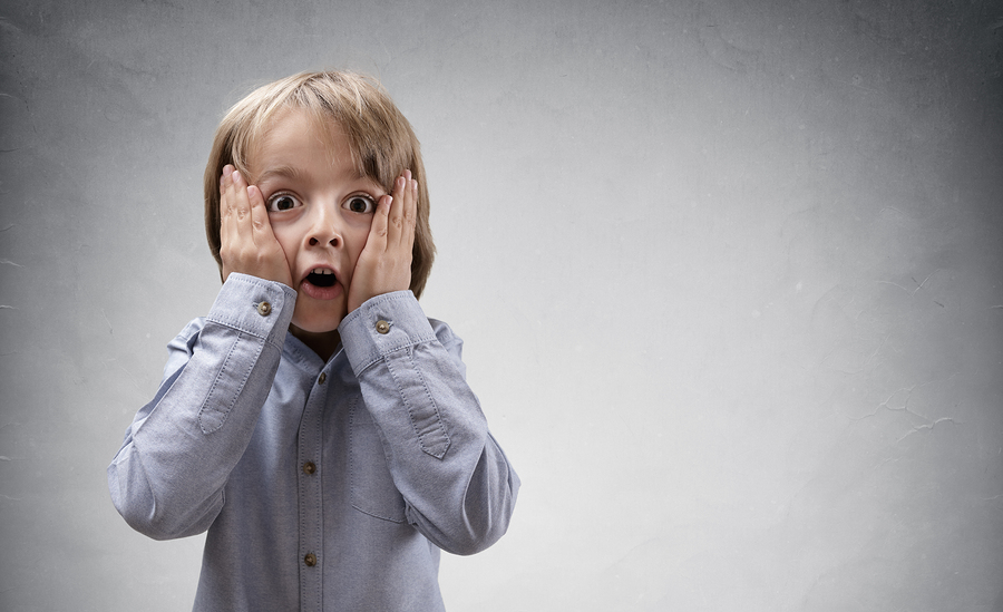 bigstock Shocked and surprised boy with 105925043