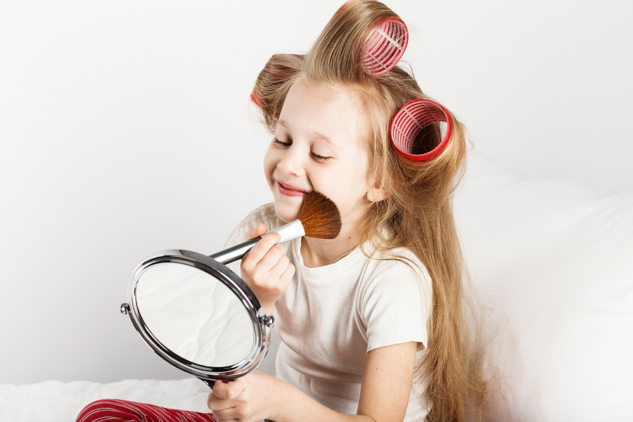 bigstock Fashion Little Girl Making Up 183487219