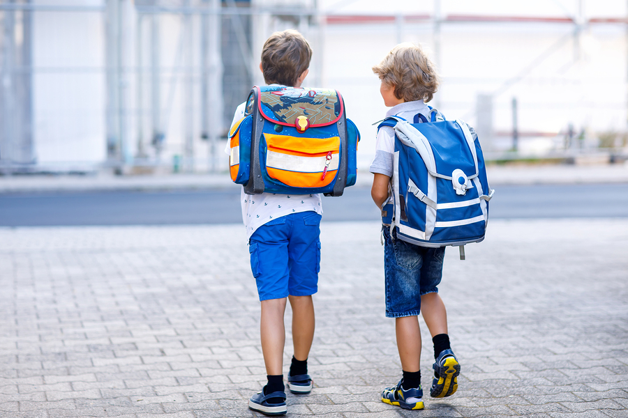 bigstock Two Little Kid Boys With Backp 252985642
