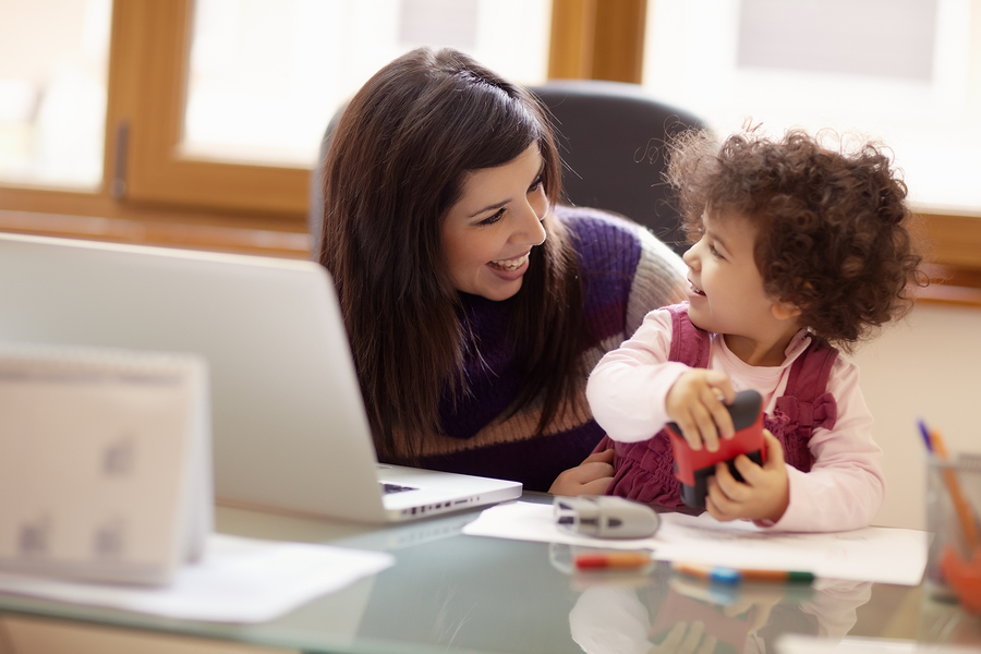 bigstock Multitasking Mother With Her D 15852617