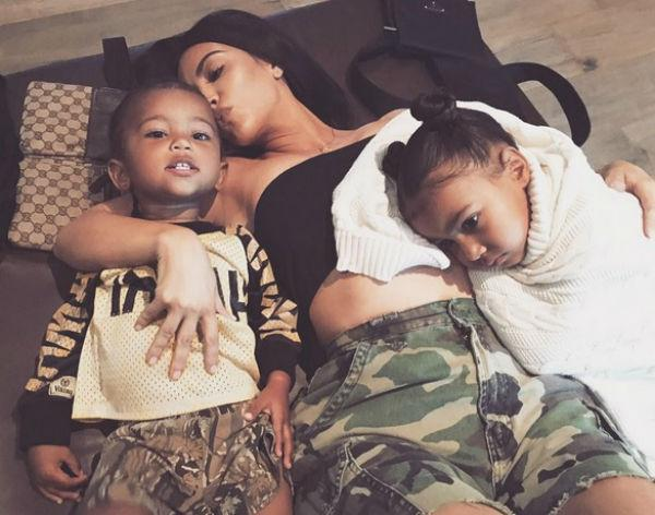 Kim Kardashian West with children Saint and North August 2017