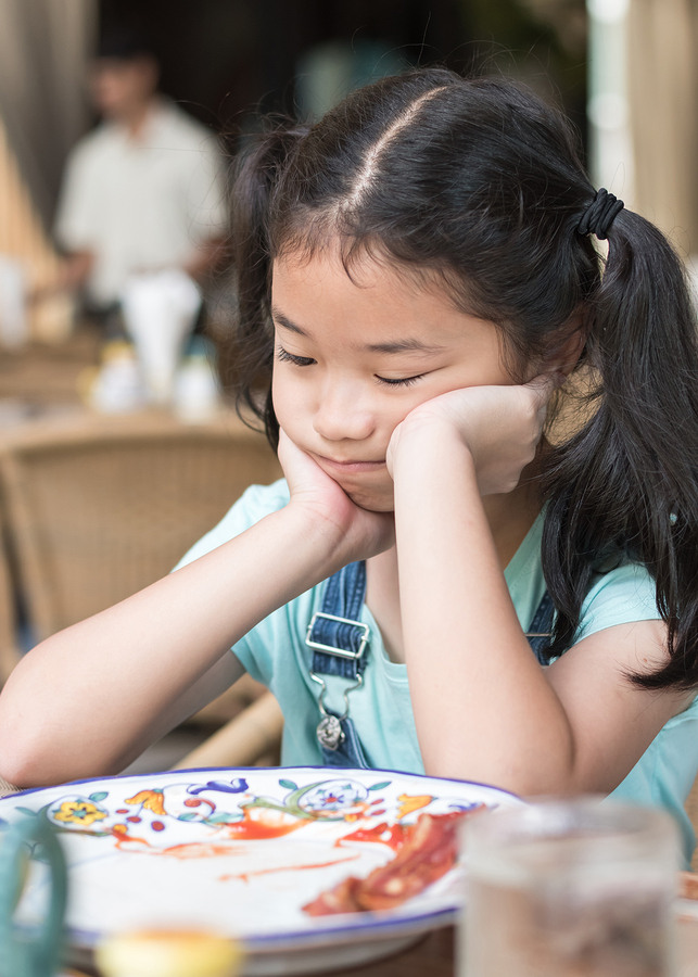 bigstock Unhappy Asian Girl Kid Getting 236357545