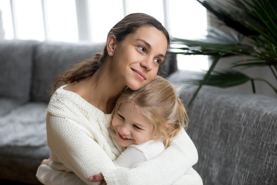 bigstock Loving Single Mother Hugging C 235958563
