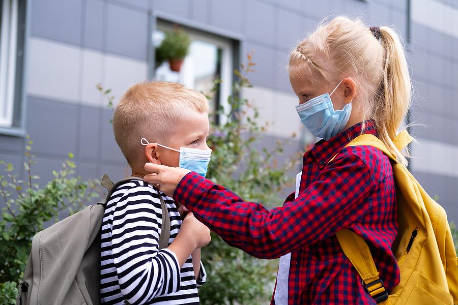 bigstock Kids Wearing Mask And Backpack 376300033
