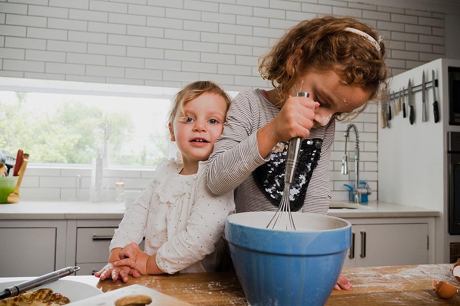 bigstock Two Smiling Siblings Baking To 390028858