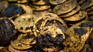 Αρχαιολόγοι ανέσυραν 285 χρυσά νομίσματα από τάφο στην Κίνα