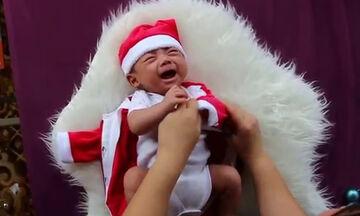 Θέλει να το ντύσει Άγιο Βασίλη όμως το μωρό έχει άλλη άποψη (vid)